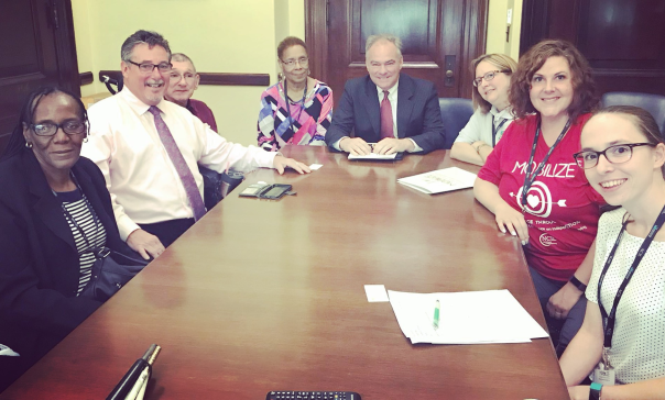 US Senator Tim Kaine pictured with representatives from Centers for Independent Living (CILS) July 24, 2018 in his DC office conference room.